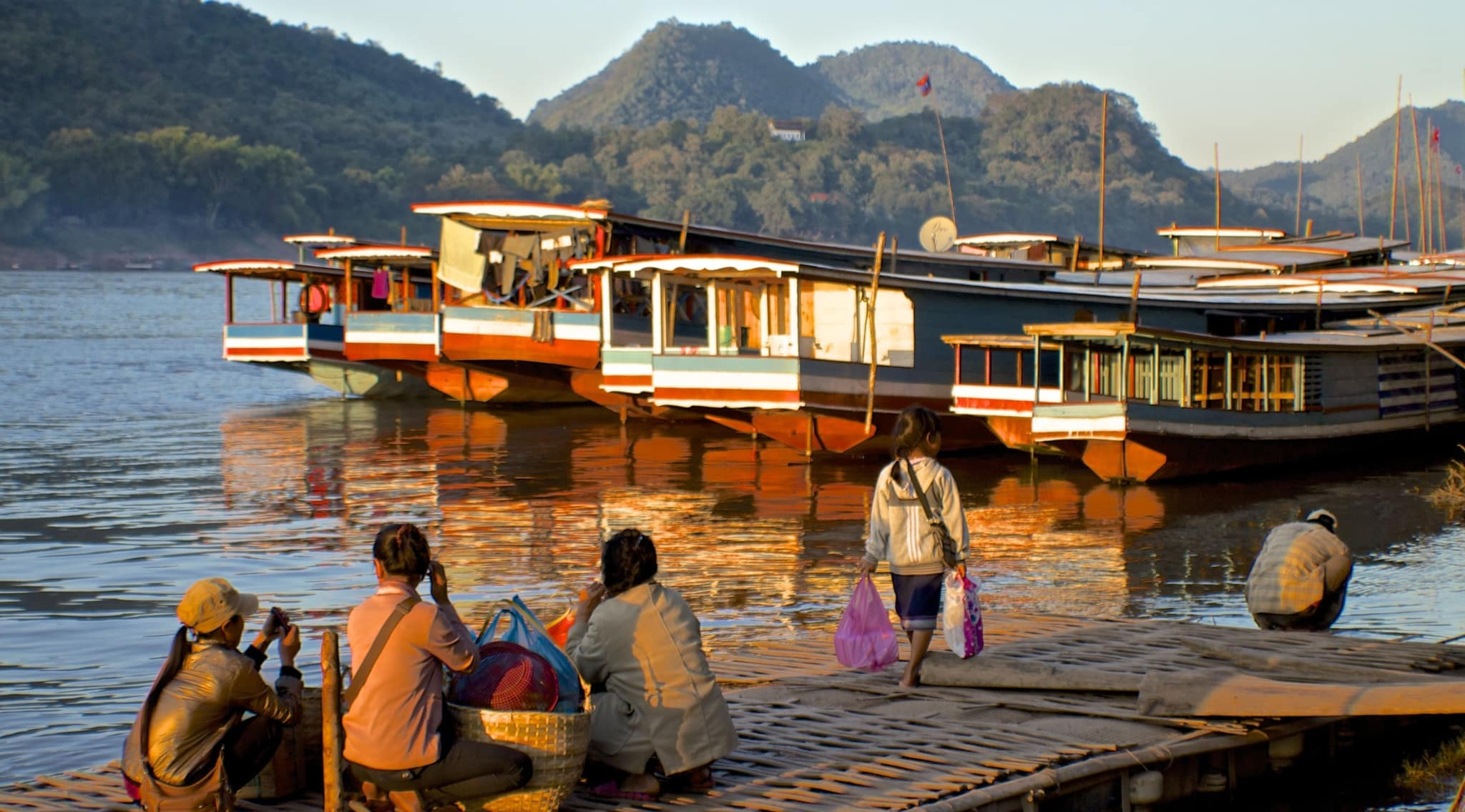 five reasons you shouldnt quit your job to travel the world mekong sunset photo essay