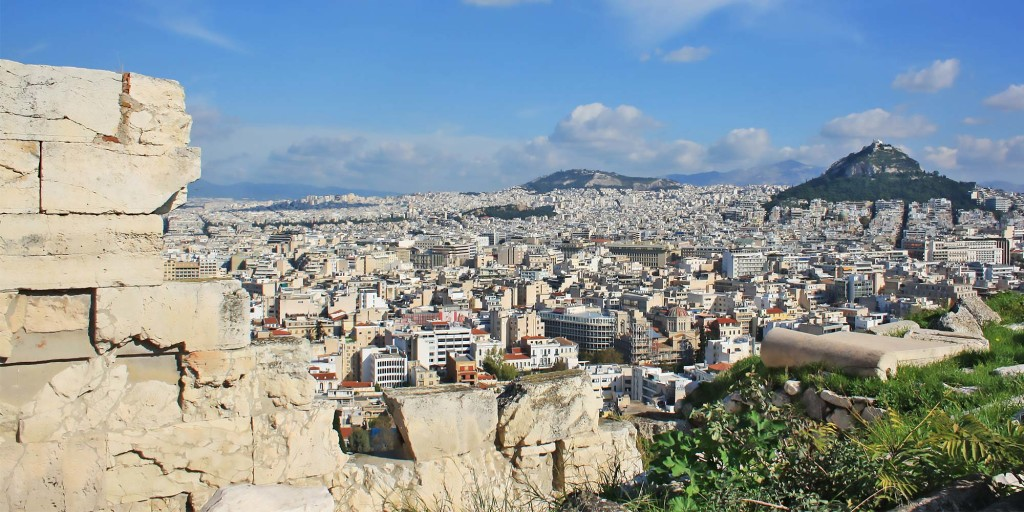 The city of Athens with the monuments rising high above atop the green hill