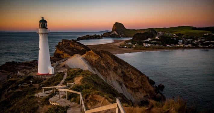 The Castlepoint lighthouse at sunrise, New Zealand