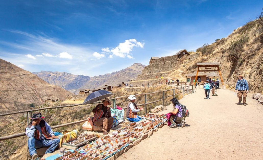 Locals sell goods on the path to Pisac ruins