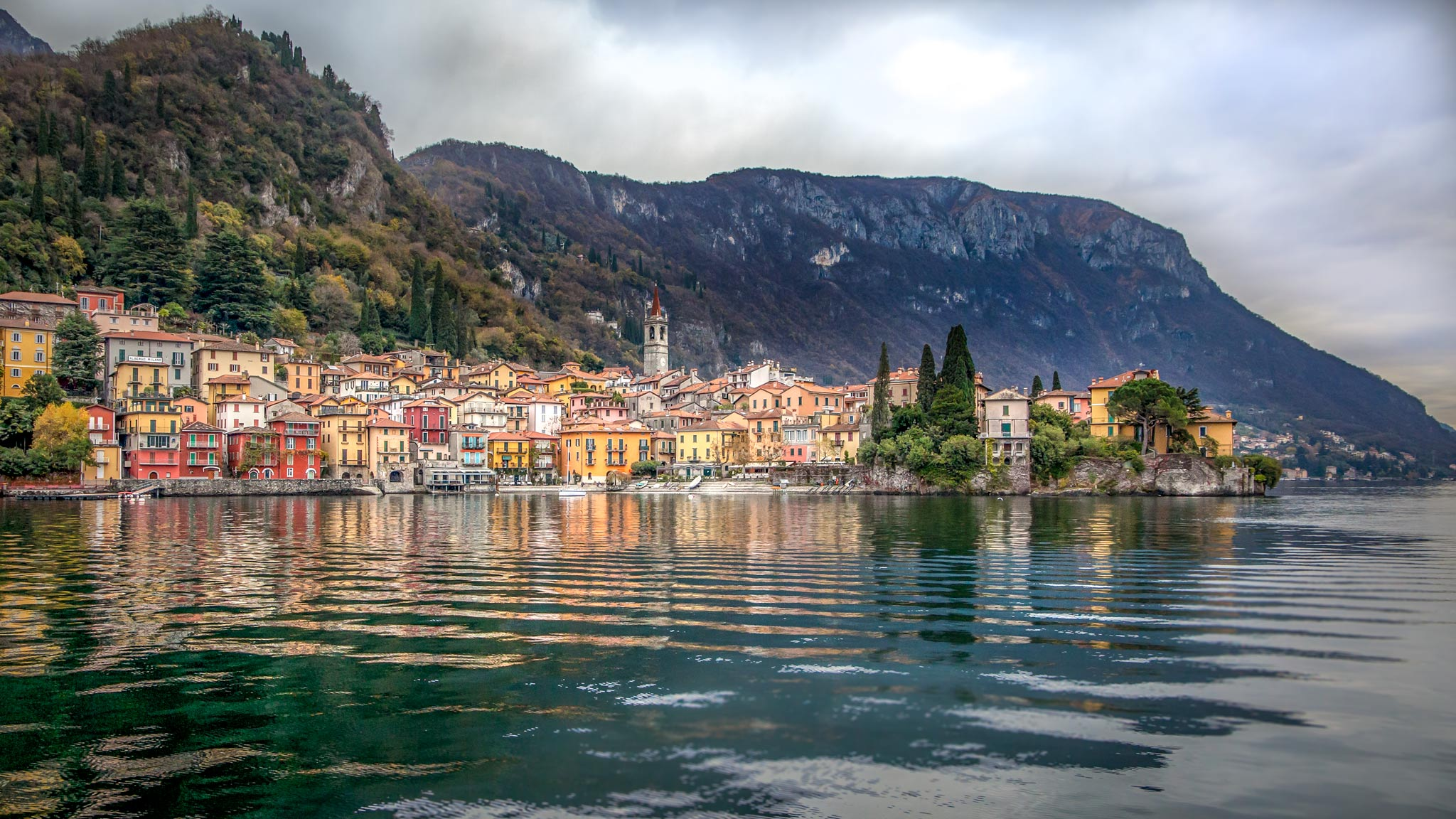Lake Como in Lombardy with the colourful village reflecting in the ocean