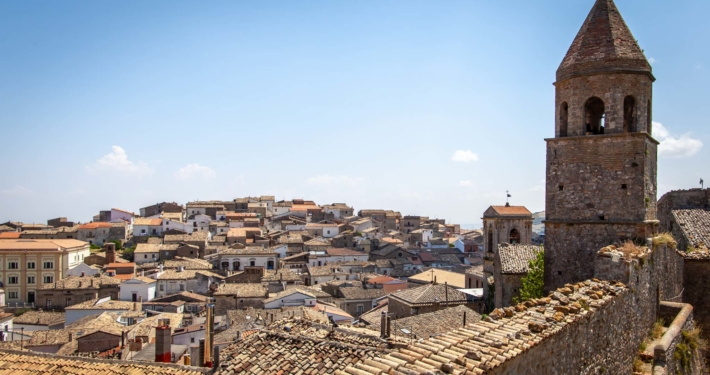 Rooftops of an Puglian town with a church tower in the foreground