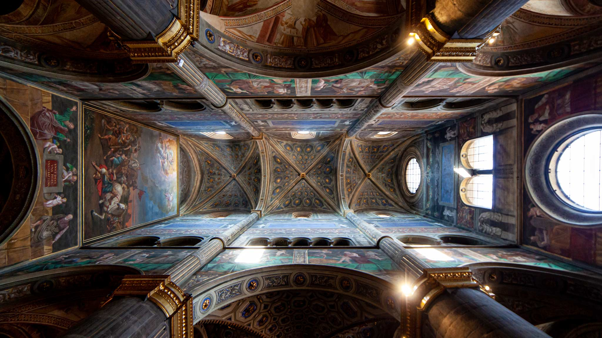 Looking up at the frescoes on the ceiling of Cremona Cathedral