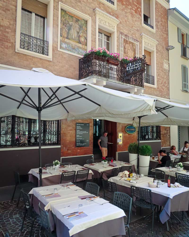 The Duomo Restaurant in Cremona, outside tables with white table cloths