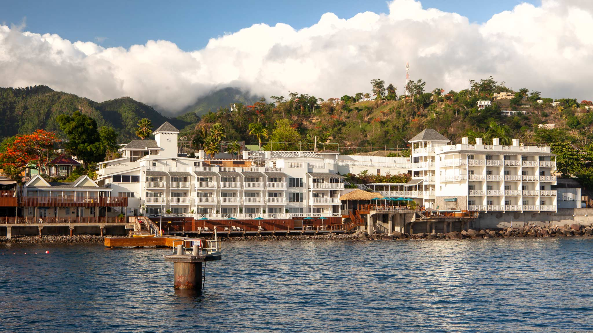 Fort Young Hotel amongst the hills of Dominica as seen from the ocean