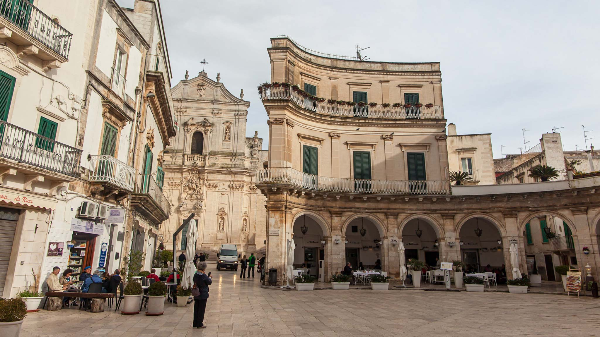 The main square of Martina Franca Puglia with arches and a cathedral