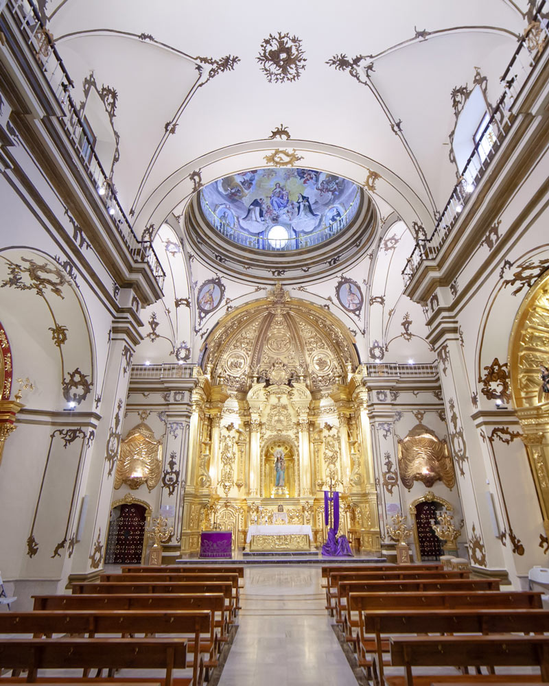 The hidden church in the muBBla museum in Lorca Spain with white walls and gold detail