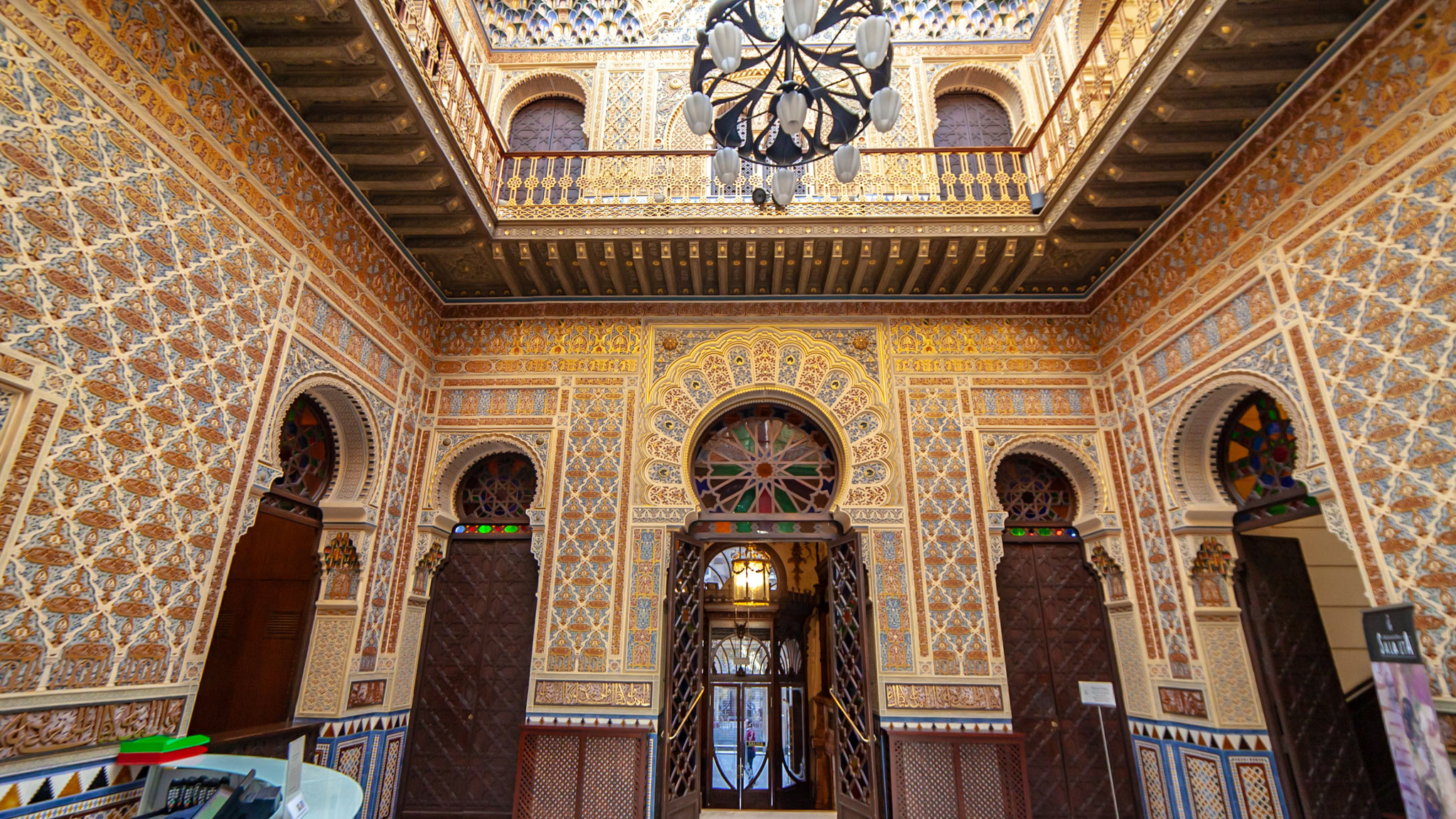 An ornate room in mainly gold and an Islamic style of design in the Real Casino of Murcia