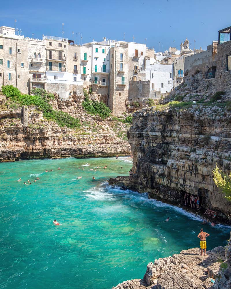 People enjoying the waters of Puglia and jumping off cliffs