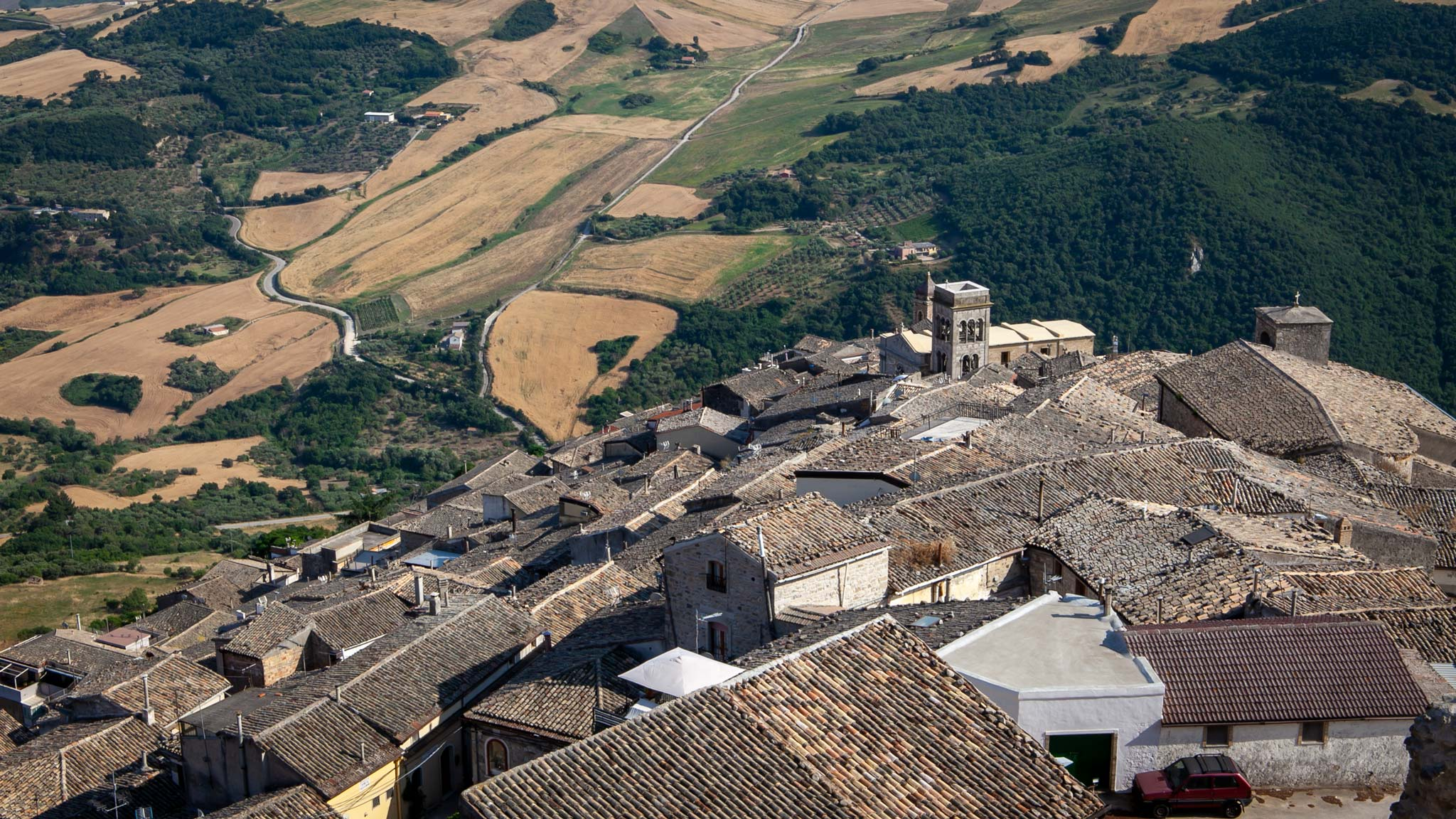 The rooftops of Sant'Agata di Puglia town with green hills in the background
