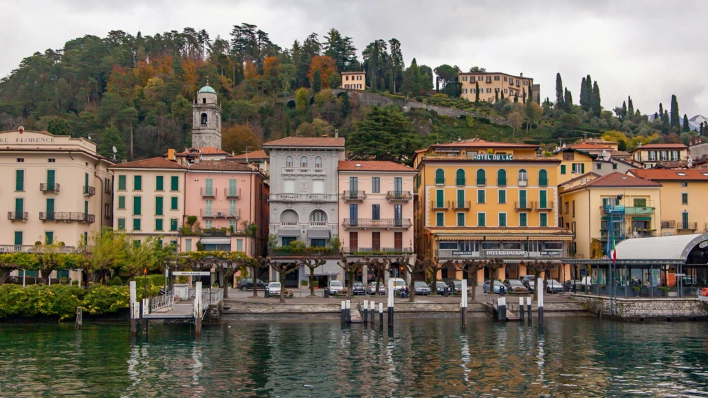Colourful houses against a green mountain make up the small village of Bellagio on Lake Como