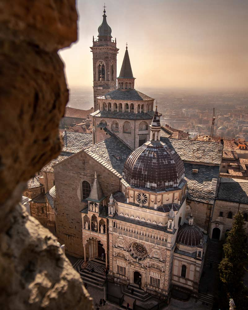The cathedral of Bergamo at sunset, as seen from a high up viewing platform