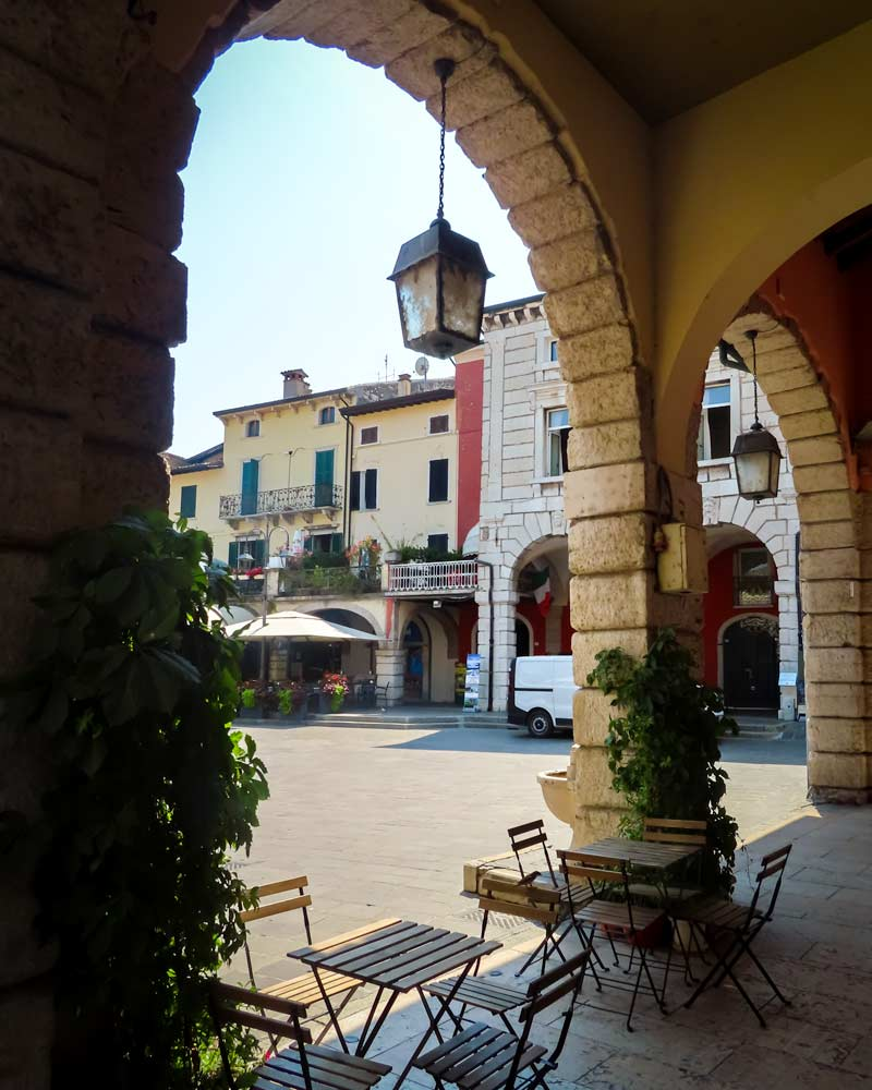 Restaurant tables under the Porticos of Desenzano del Garda