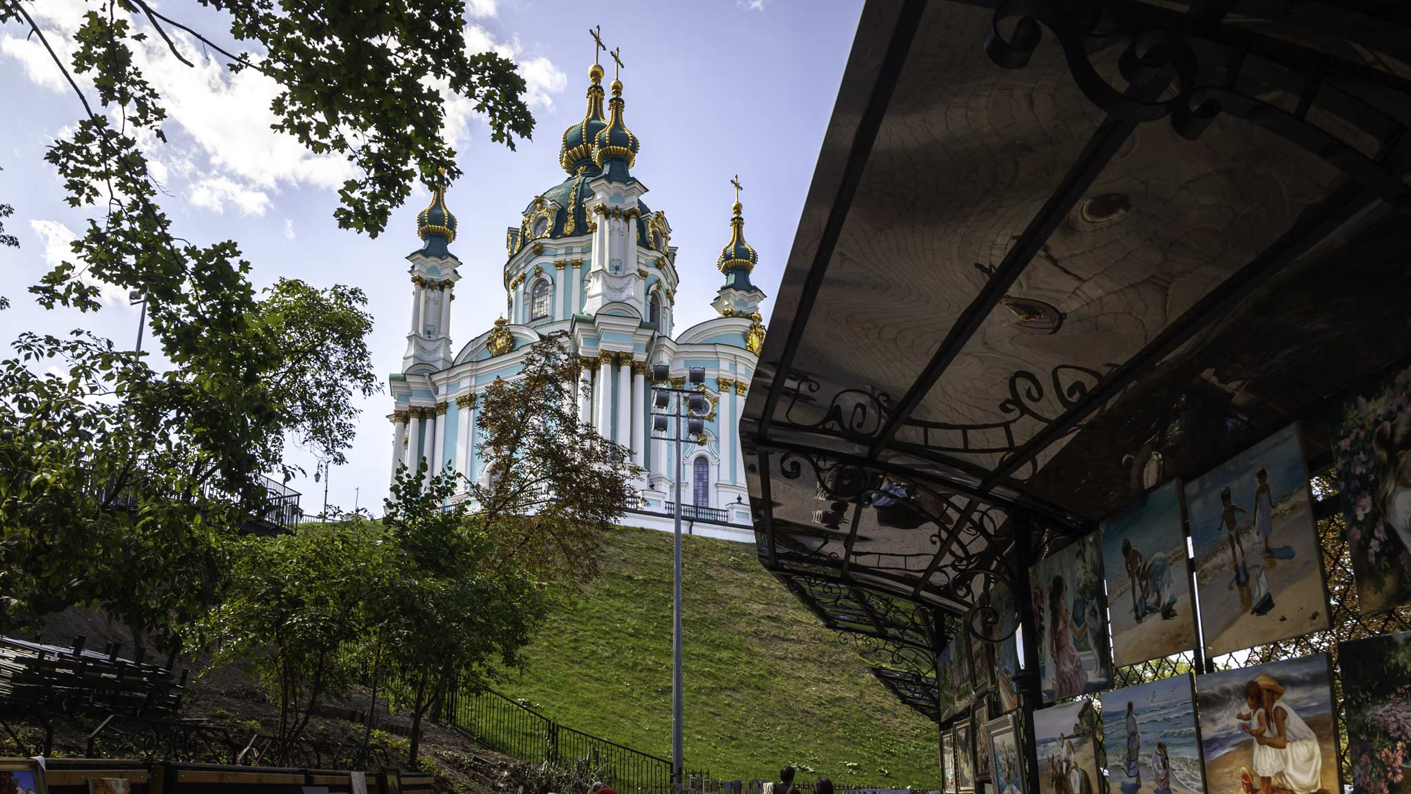 A cathedral in Kyiv Ukraine framed by an art stool on the bottom right