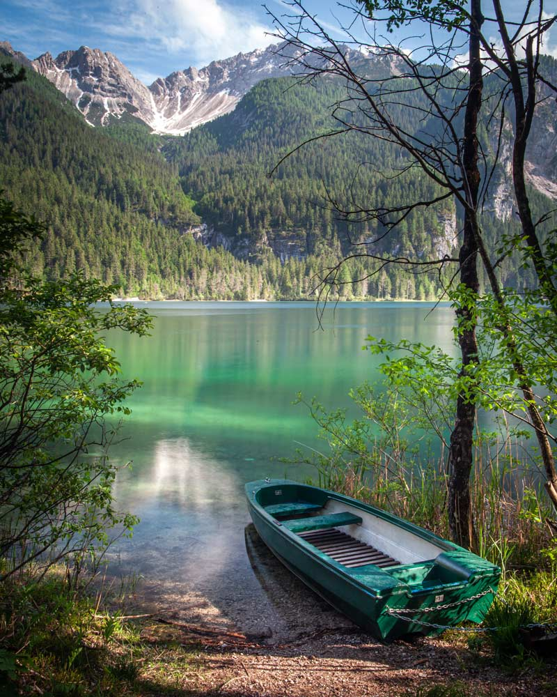 A boat sits by the edge of Lake Tovel in Trentino