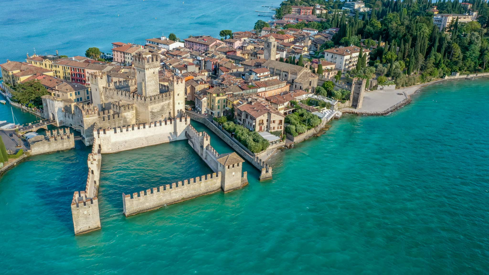 The castle of Sirmione as seen from above with the island behind it