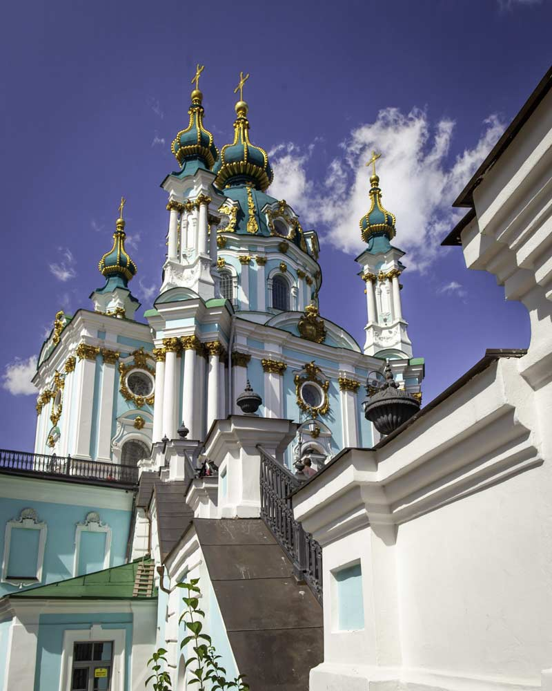 St Peters Cathedral in Kyiv atop a staircase, an orthadox style green cathedral
