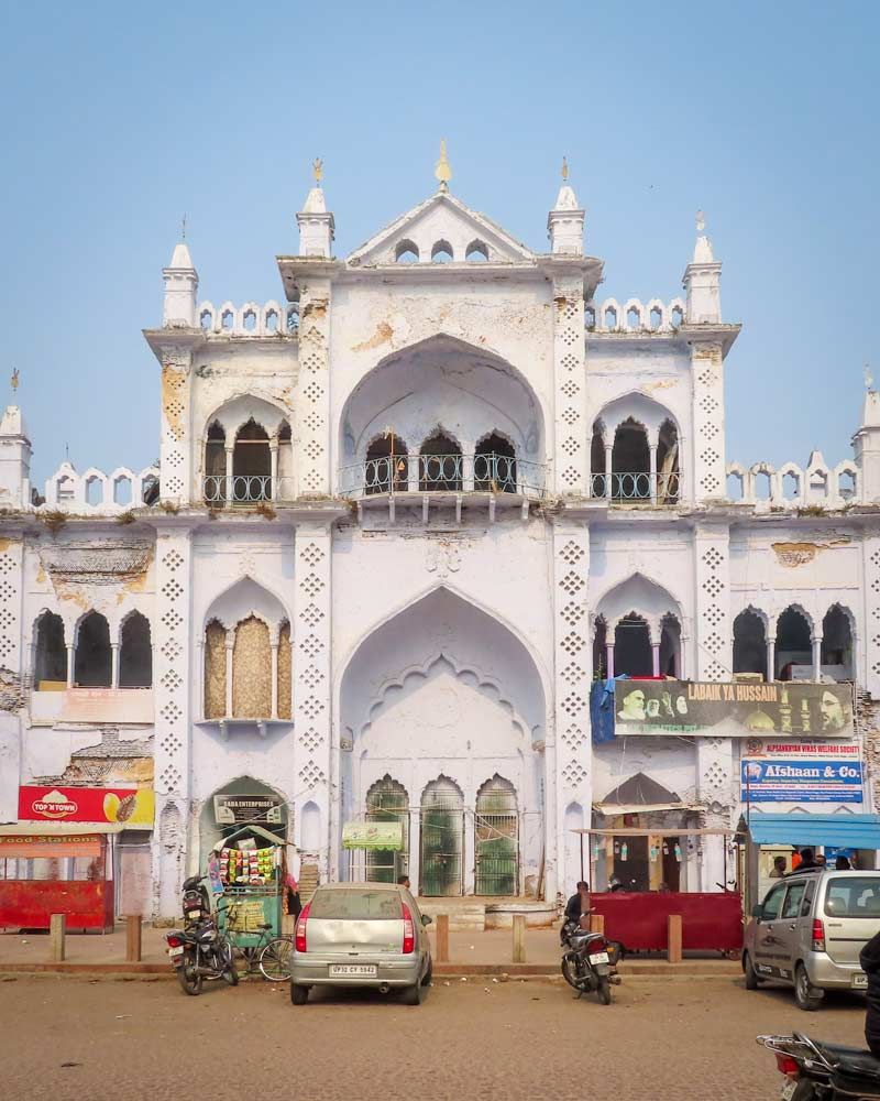 A popular white building with various windows and pillars in Lucknow India