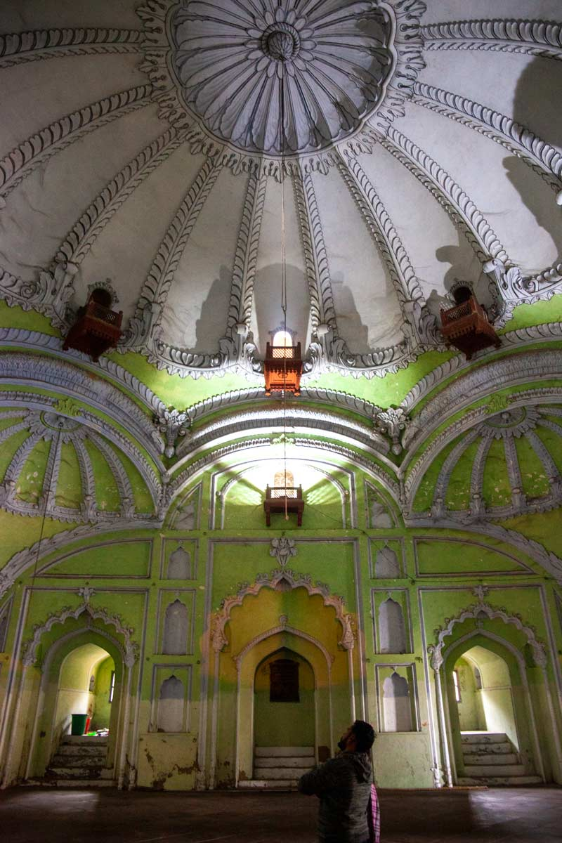 A green wall meets a white domed roof inside the Bara Imambara Mosque Lucknow India