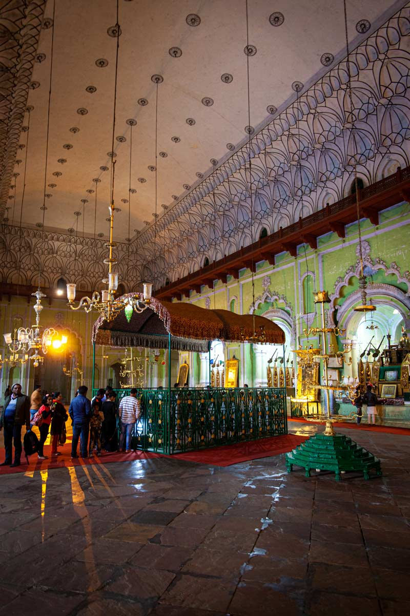 Inside the Bara Imambara in Lucknow is a detailed hall where people line up to pray