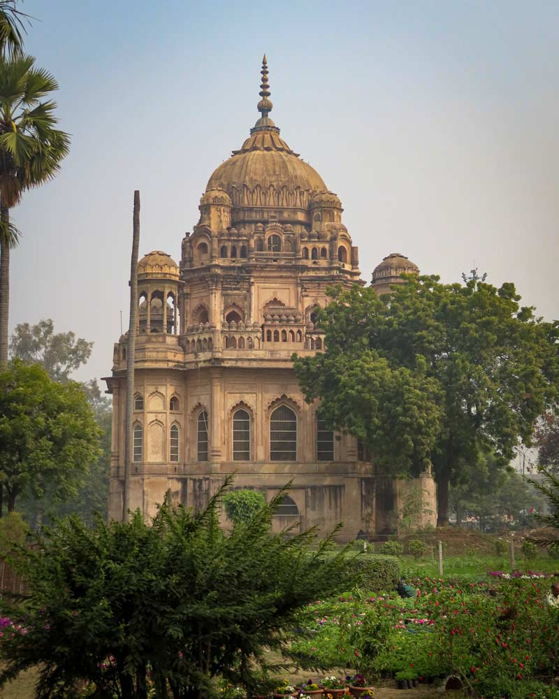 Hidden amongst trees and planets is a well preserved old religious building in Lucknow India