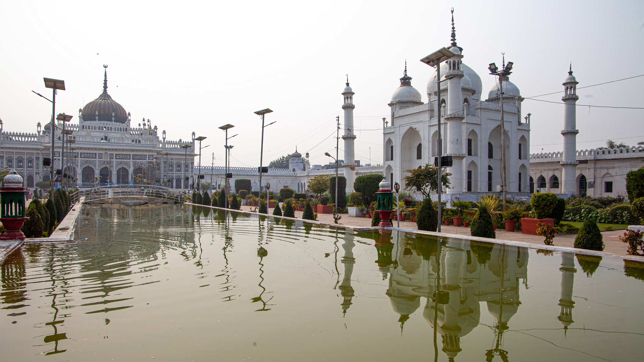 Reflections of the white mosque on a smoggy day