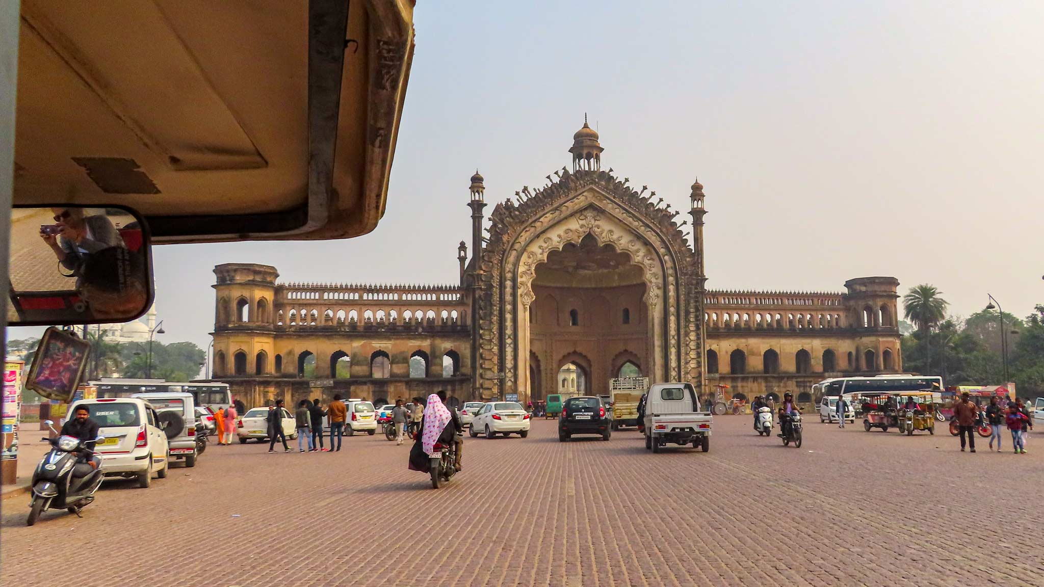 The Rumi Darwaza Gate, a large gate to the city on the road, as seen from an auto rickshaw
