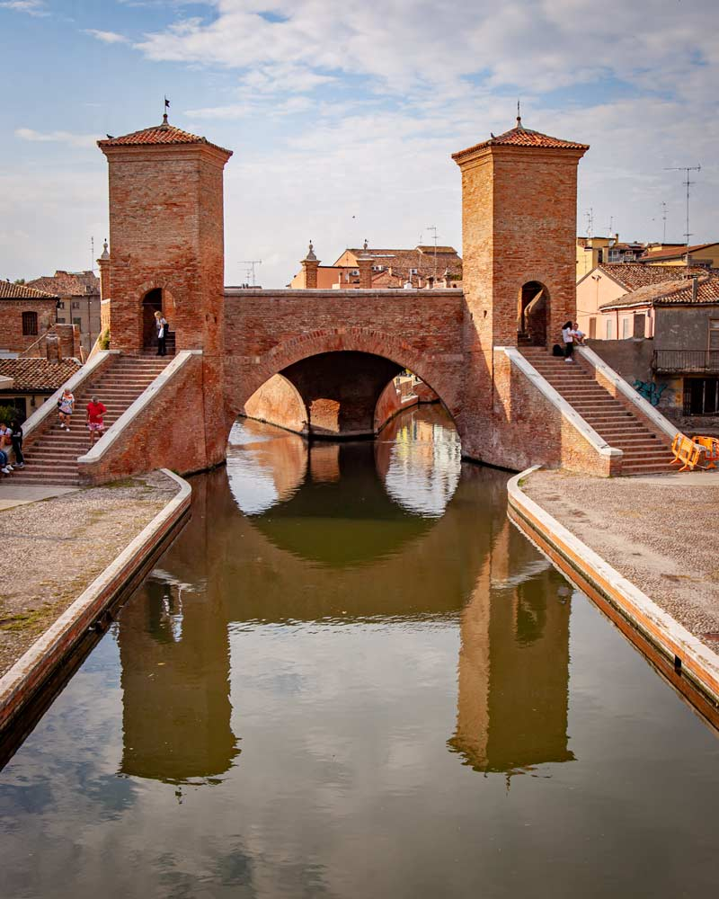 A bridge in Comacchio reflected in the water