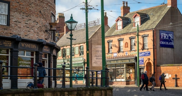 A street in Beamish Museum, with old fashioned shops and tram rails