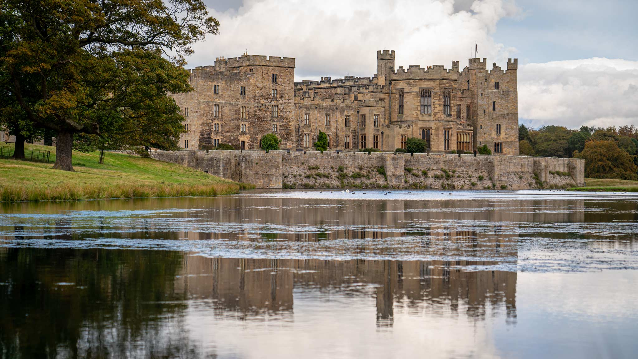 Raby Castle reflected on the water around it