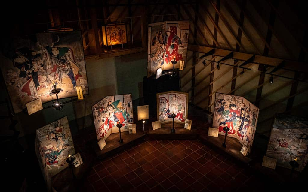 Inside the Ekin Museum, where art works are lit by little lamps