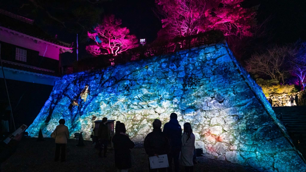 The Kōchi Castle walls illuminated with the projections of teamLab