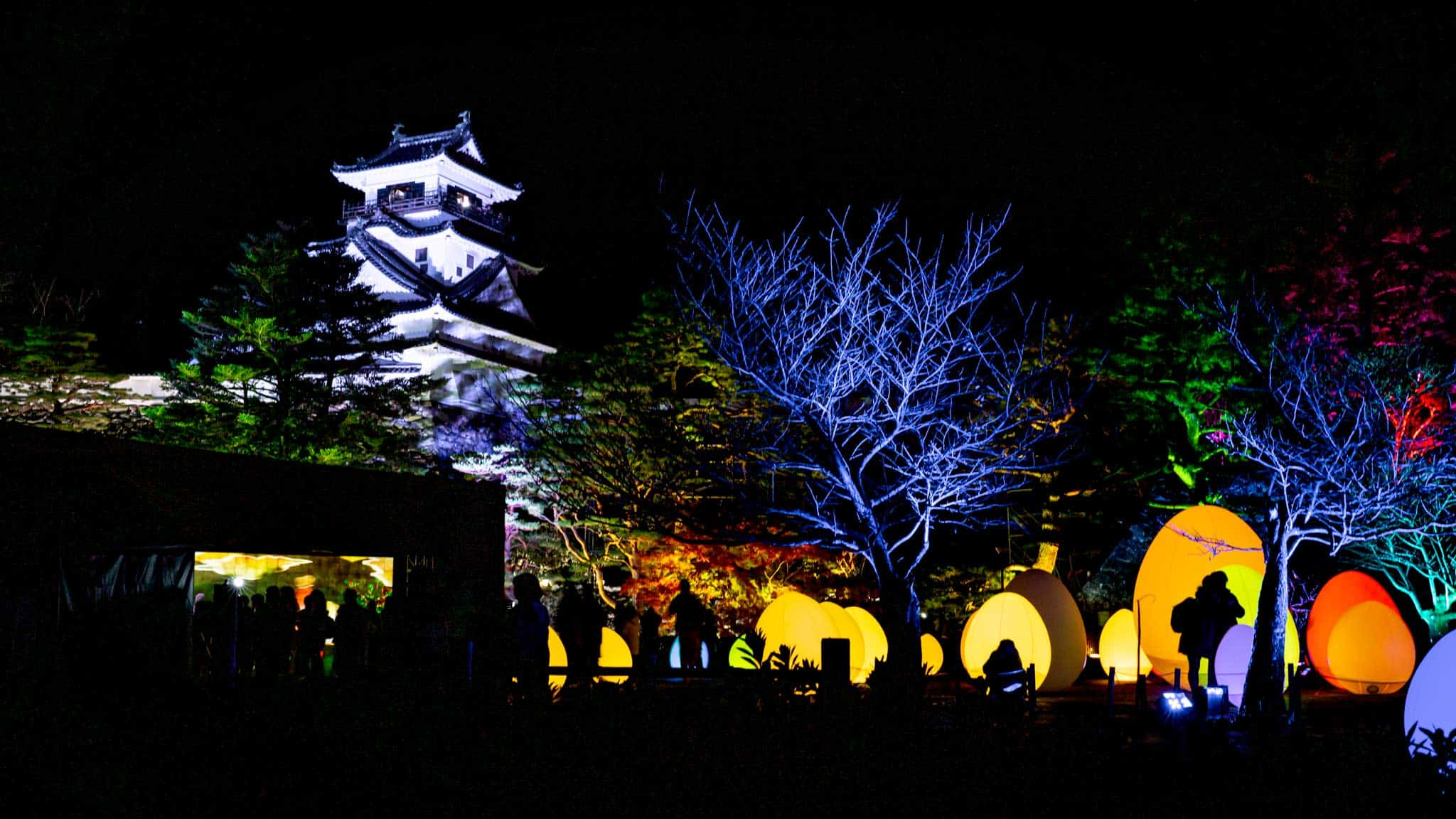 Kōchi Castle shines high above the coloured teamLab work