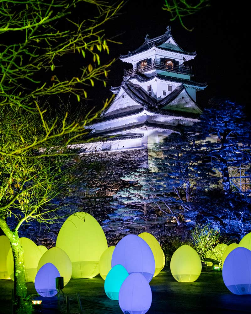 Kōchi Castle illuminated in the various colours of projection