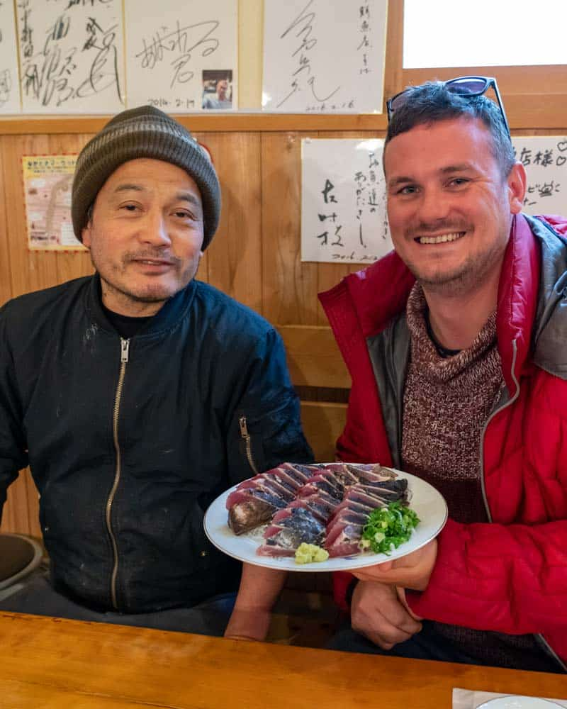 Dan and the chef sit with a plate of Katsuo no Tataki