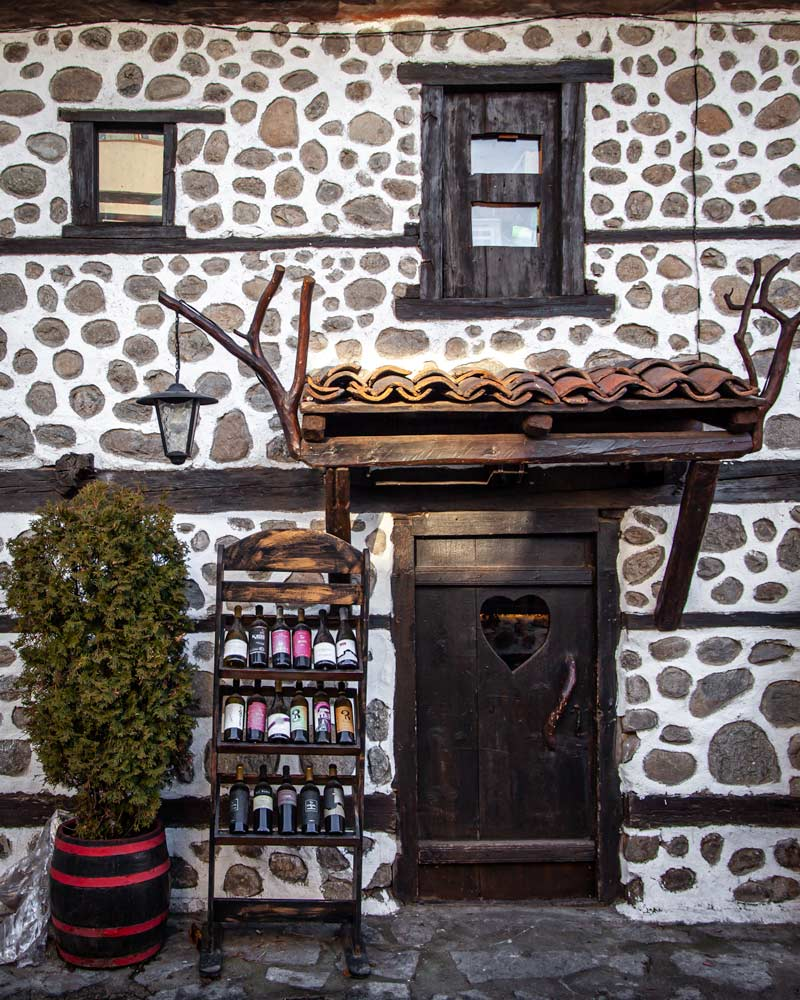 A stone restaurant with wine racks in Bansko old town