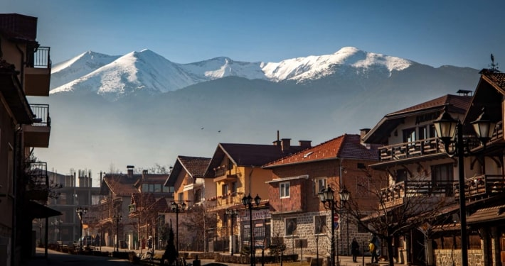 The view of old town Bansko and the snowy mountains