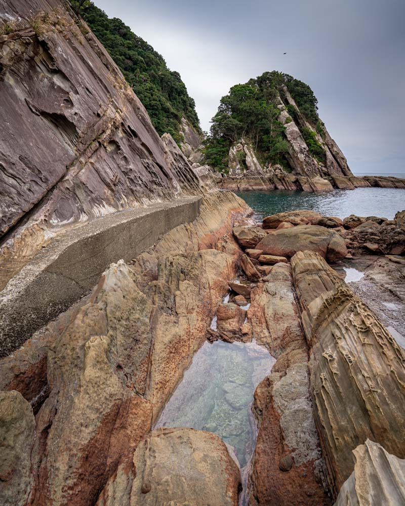 The dramatic rocky coastline made through thousands of years of activity