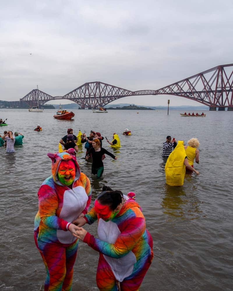 Dookers in their fancy dress costumes in front of the Forth bridge