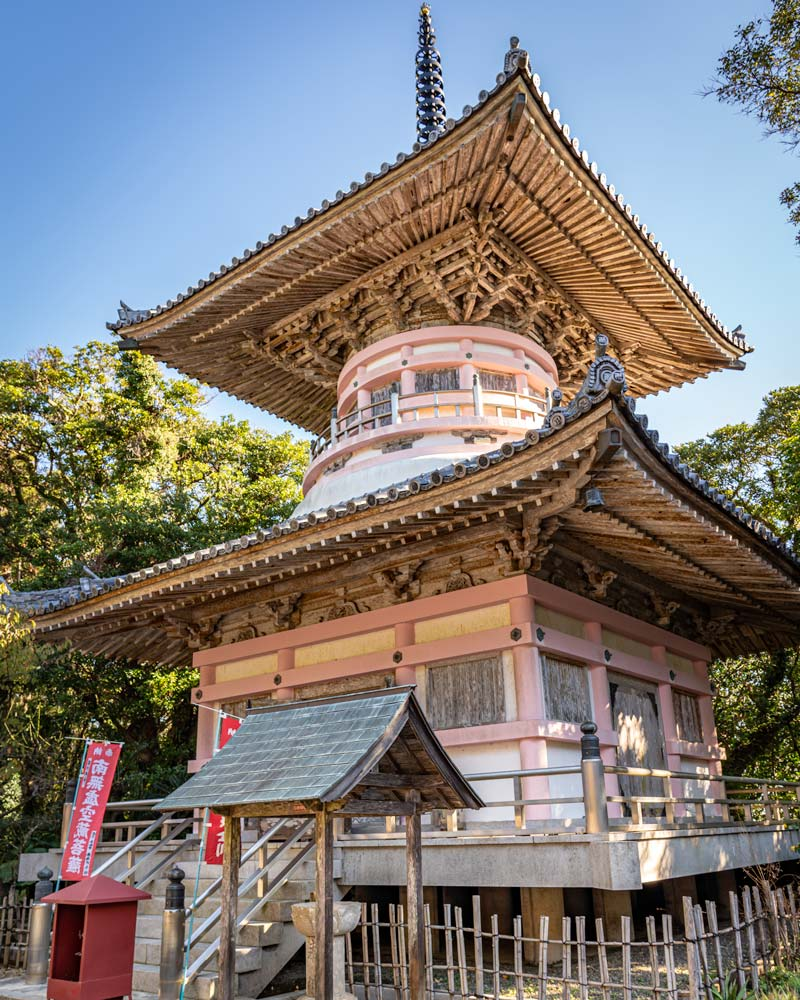 a pink and white temple in Kochi Japan