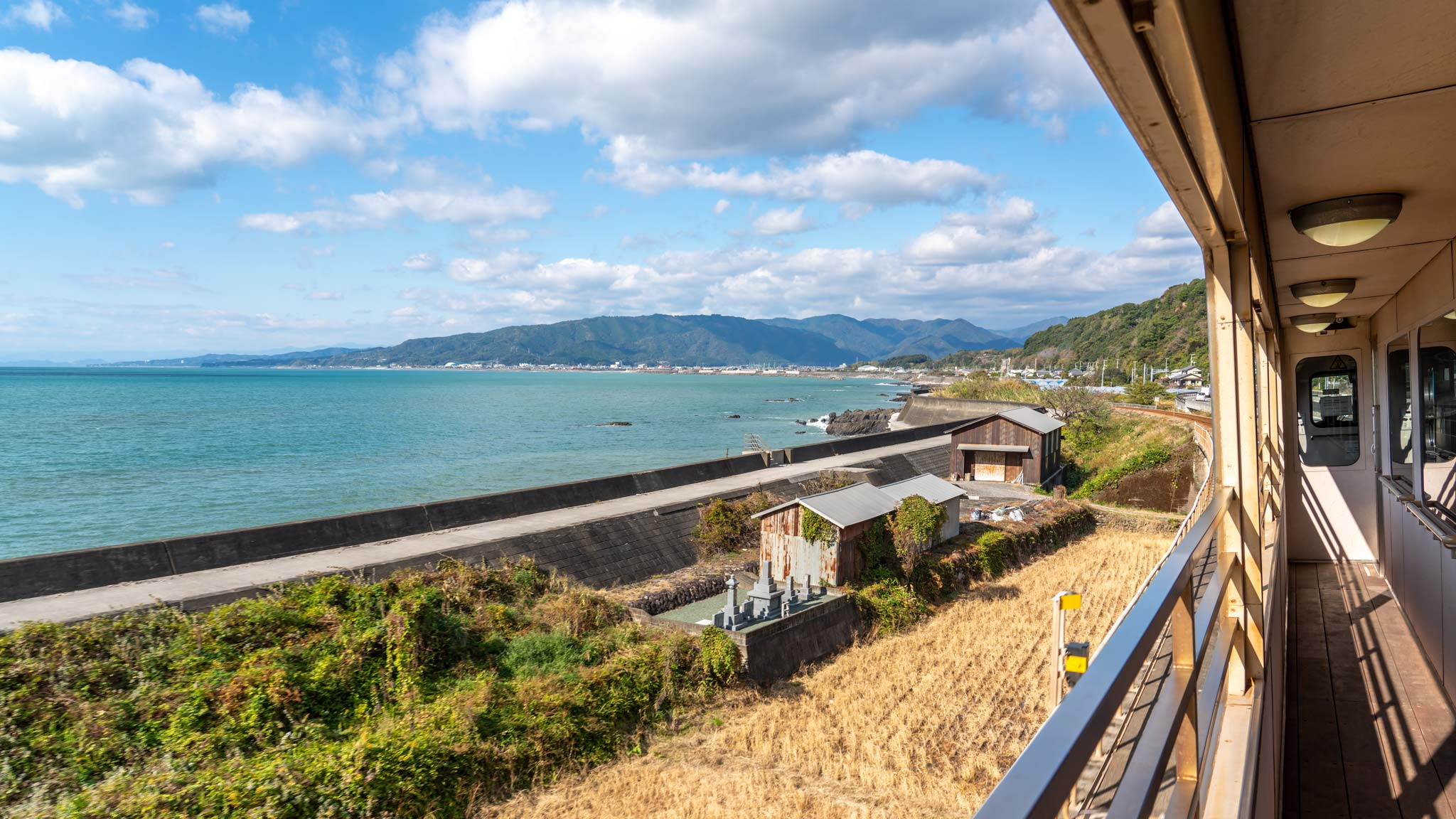 An open sided train in Kochi, Japan, looks out to the ocean