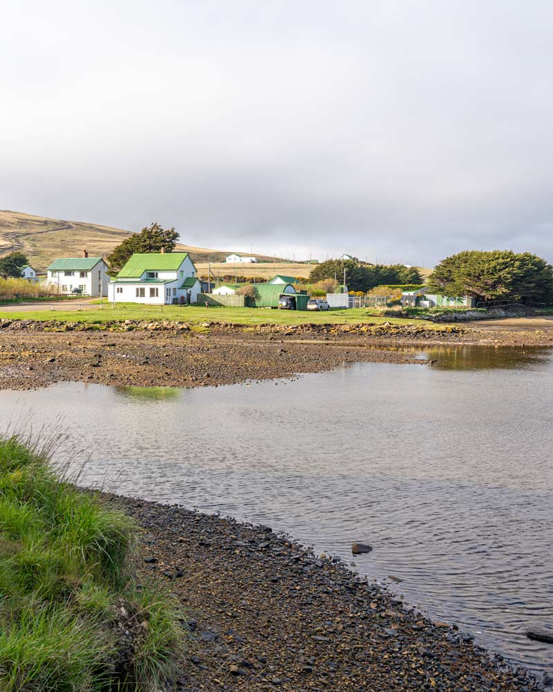 The white buildings and green roofs of Port Howard lodge