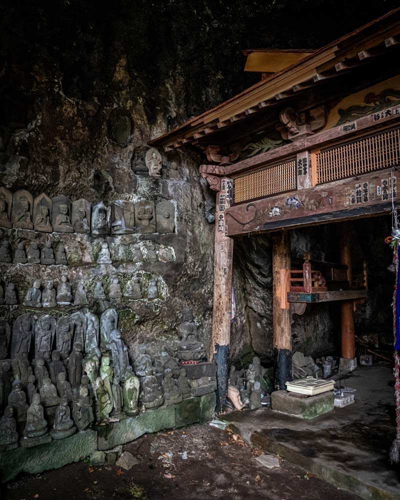 Inside the cave temple of the hotel where lots of statues sit