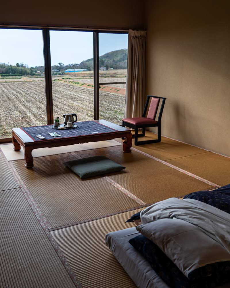 A traditional Japanese bedroom with a futon on the floor