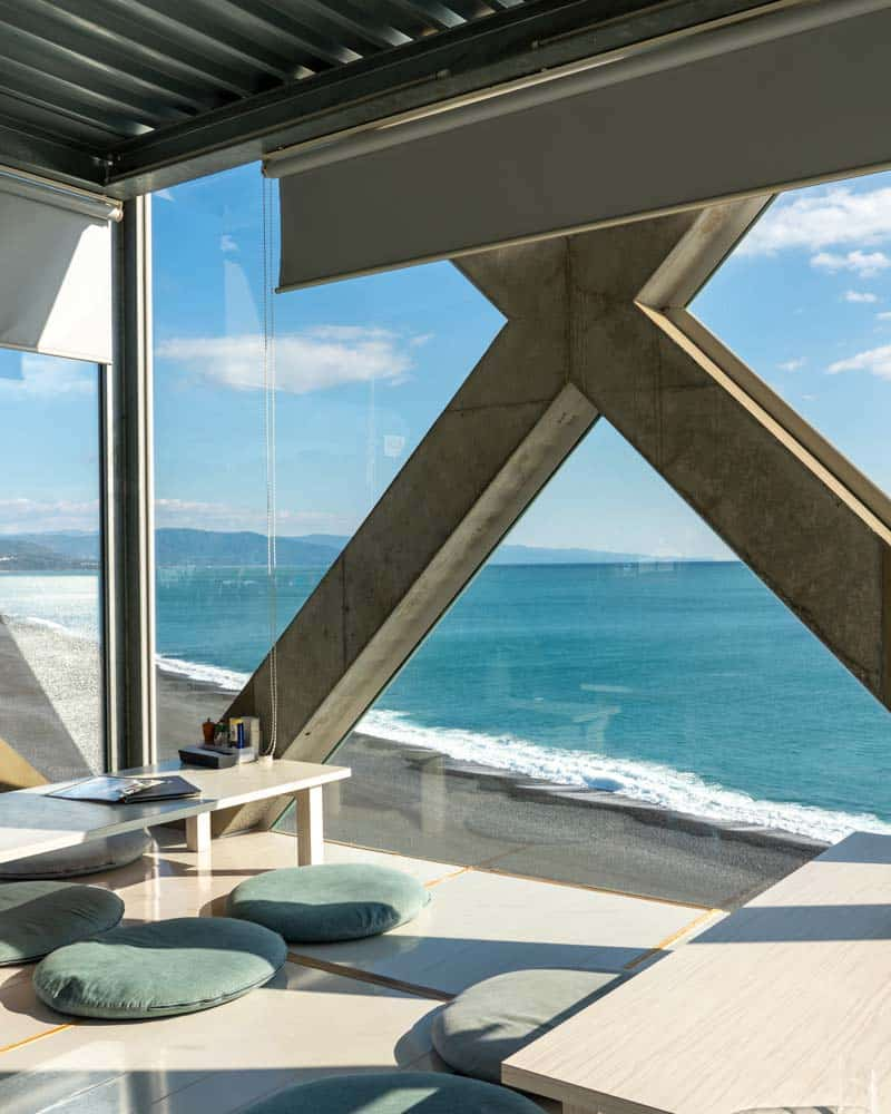 Sea house is a glass restaurant looking out on the ocean
