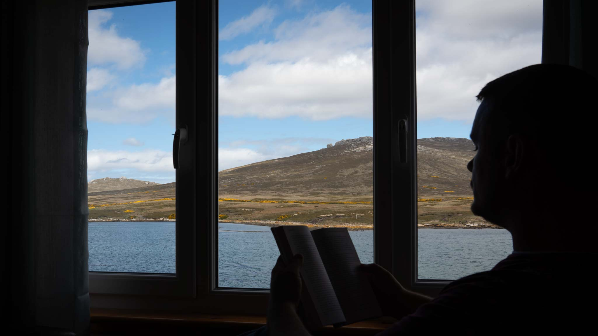 Enjoying a book and the views on Weddell Island