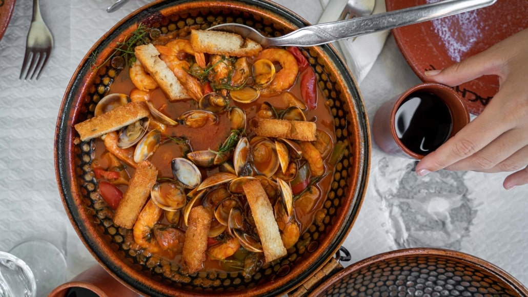 Traditional Cataplana prawn and clam dish in Portugal