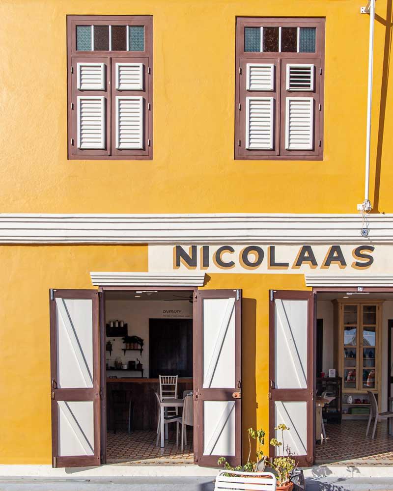 A bright yellow cafe in San Nicolas