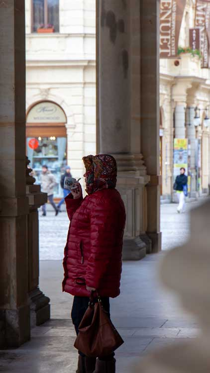 Karlovy Vary a lady drinks from a spa cup