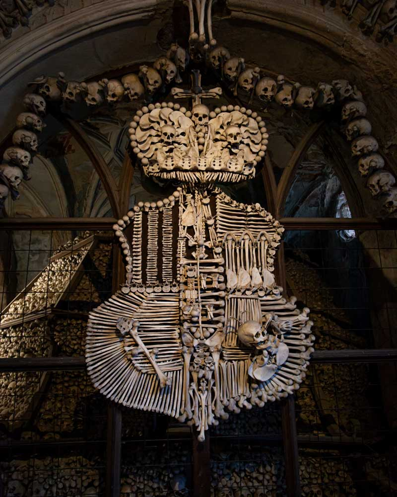 A coat of arms made of bones in the Bone Chapel of Kutna Hora